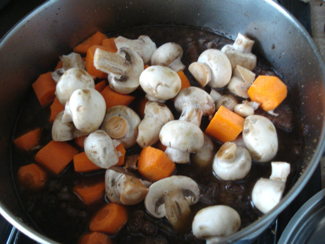 Add button mushrooms and carrots