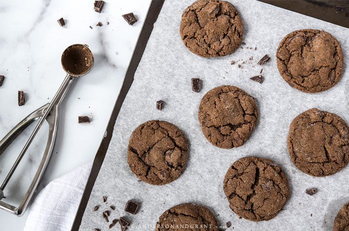 Chocolate chunk gingerbread cookies on cookie sheet