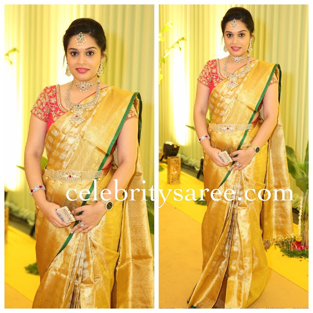 Golden Silk Saree with Red Blouse
