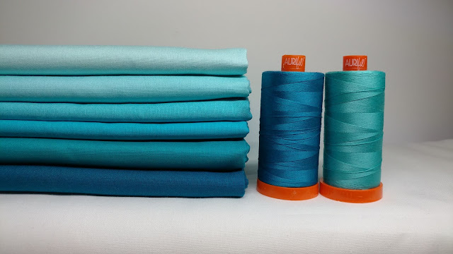 Kona solid aqua and turquoise fabrics with turquoise Aurifil thread