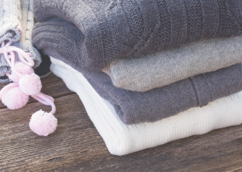 Folded clothes in a post about five areas to start decluttering for a more simple life.