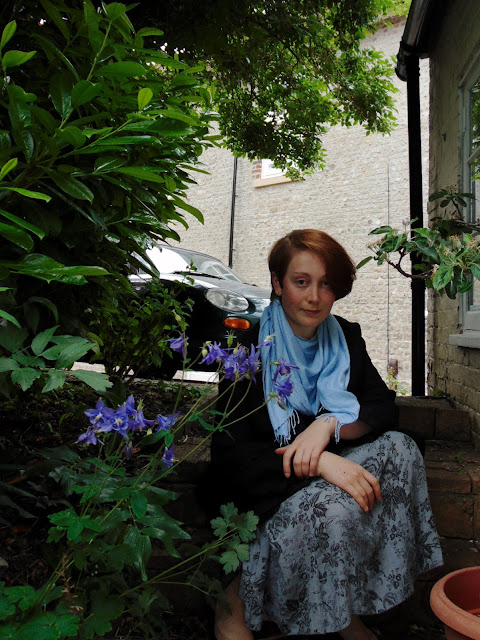 Black cocoon skirt, blue pashima, grey floral midi skirt