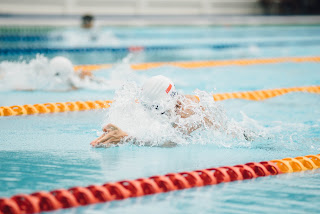 Image of a swimmer starting their breaststroke glide in a pool