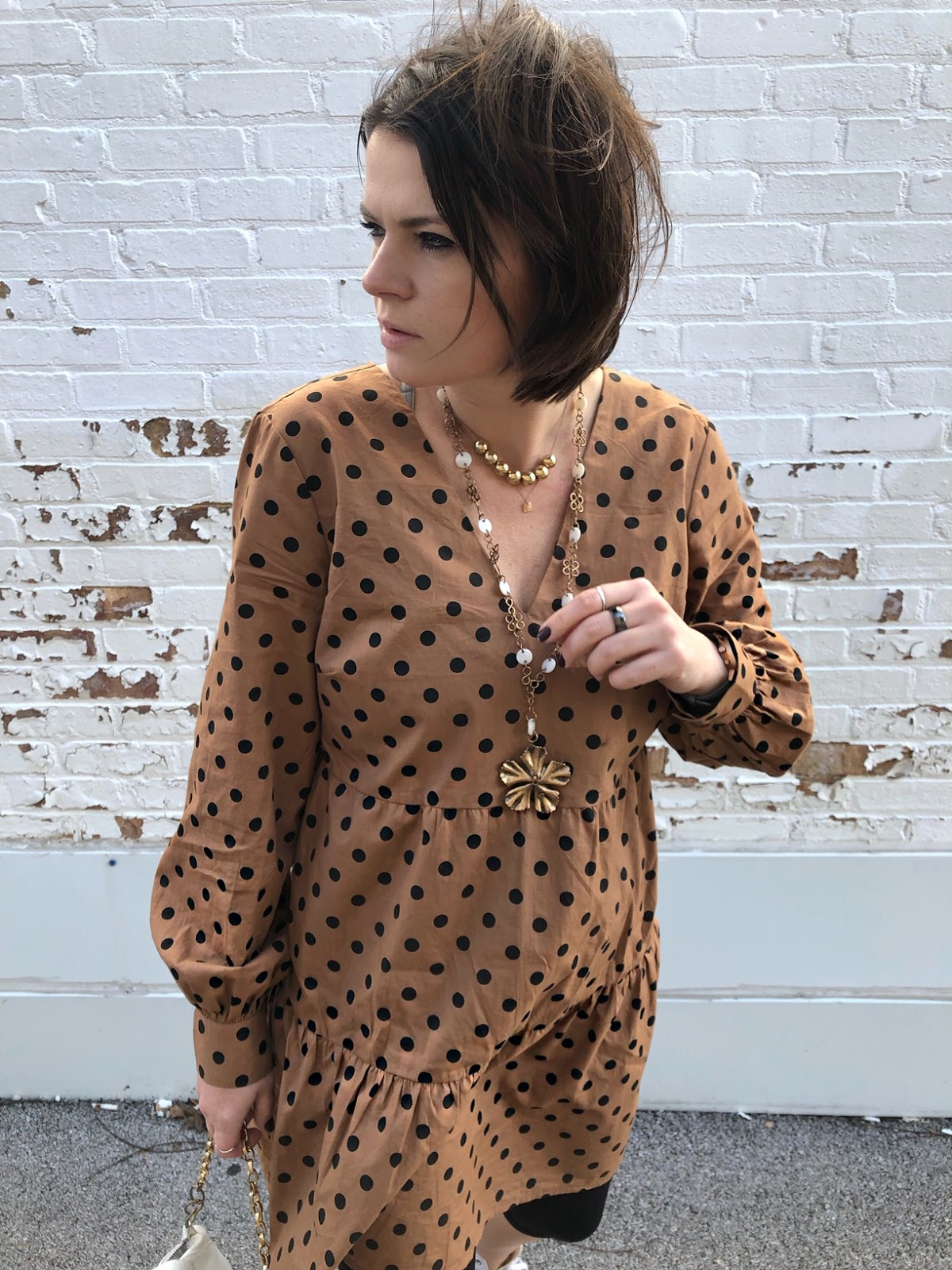 A very versatile camel color dress with black polka dots