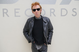 Ewen Bremner as Alan McGee, ginger haired lout in a denim jacket.