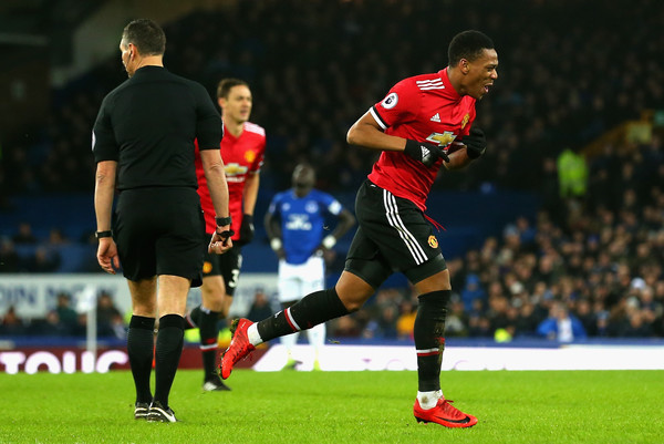 Anthony Martial of Manchester United celebrates after scoring his sides first goal during the Premier League match between Everton and Manchester United at Goodison Park on January 1, 2018 in Liverpool, England
