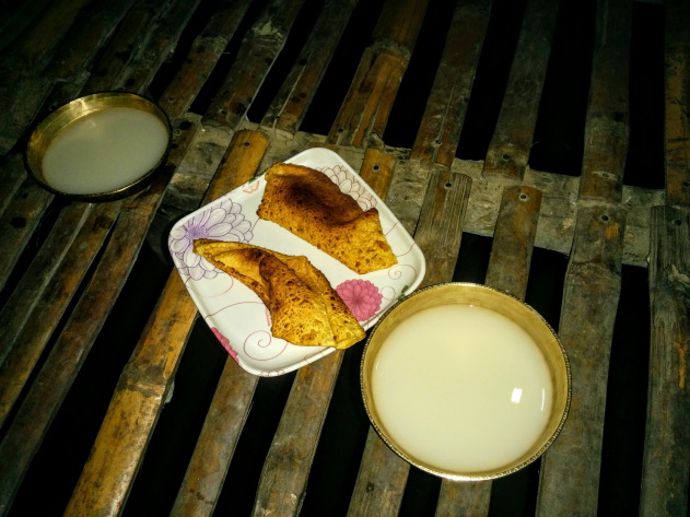 Rice beer and Chang ghar dining - Mishing tribal village, Assam