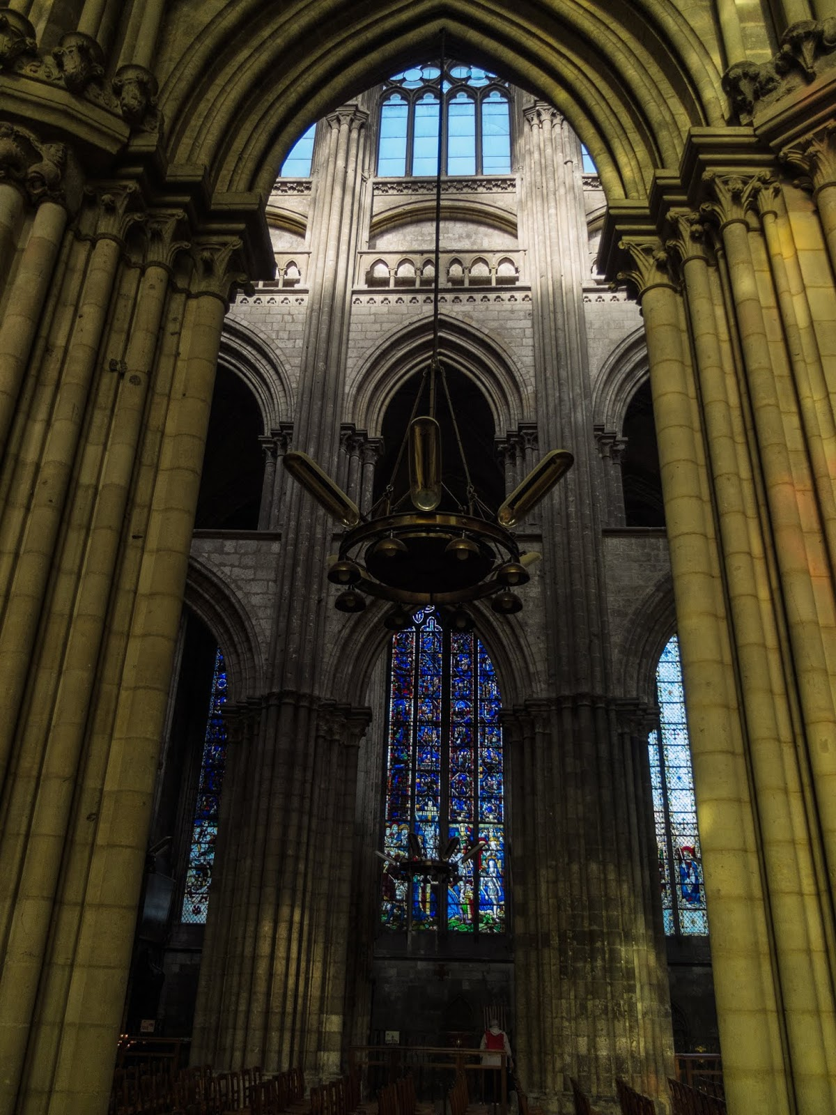 Stained glass and reflections inside the Rouen Cathedral.