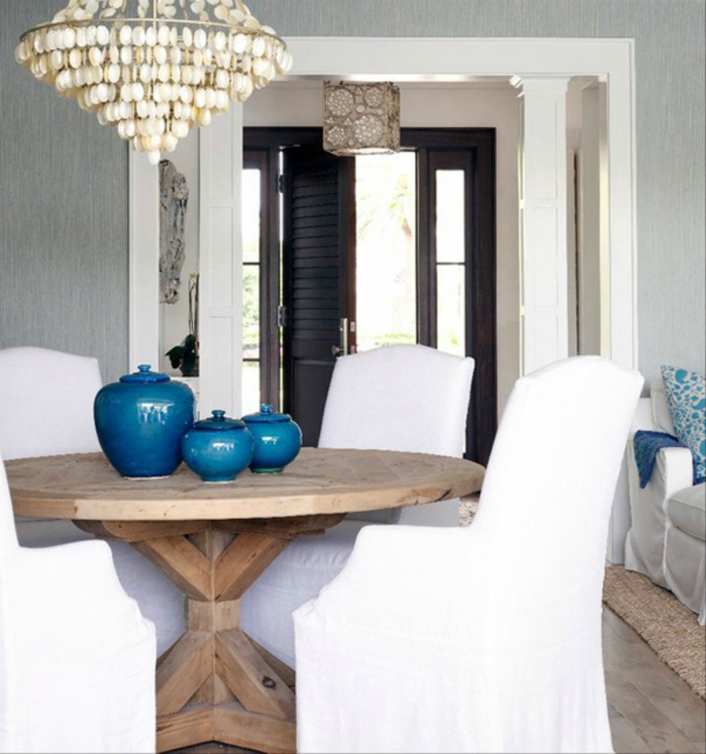 Coastal dinign room with shell chandelier and white slipcover chairs