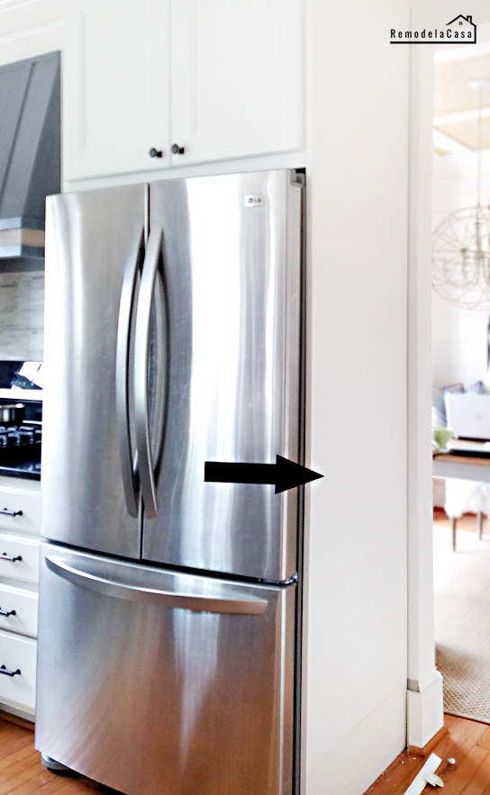 LG refrigerator in enclosed DIY cabinet and with  plate rack on the side.