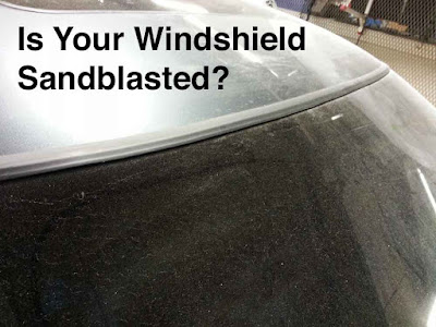 "Photo of a sandblasted windshield with the headline: ""Is Your Windshield Sandblasted?"""