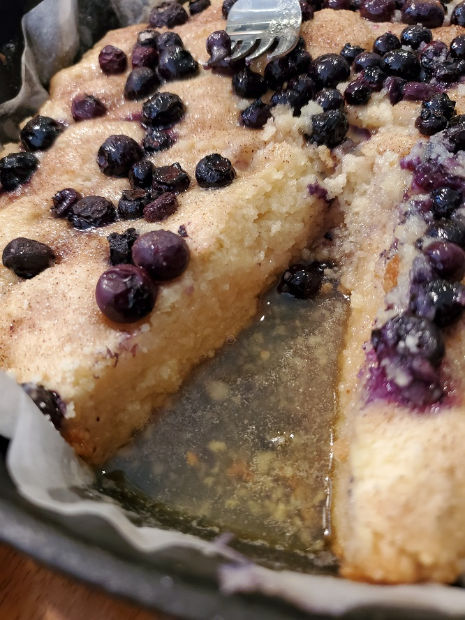 this is a shortcake with blueberries and covered in rum sauce