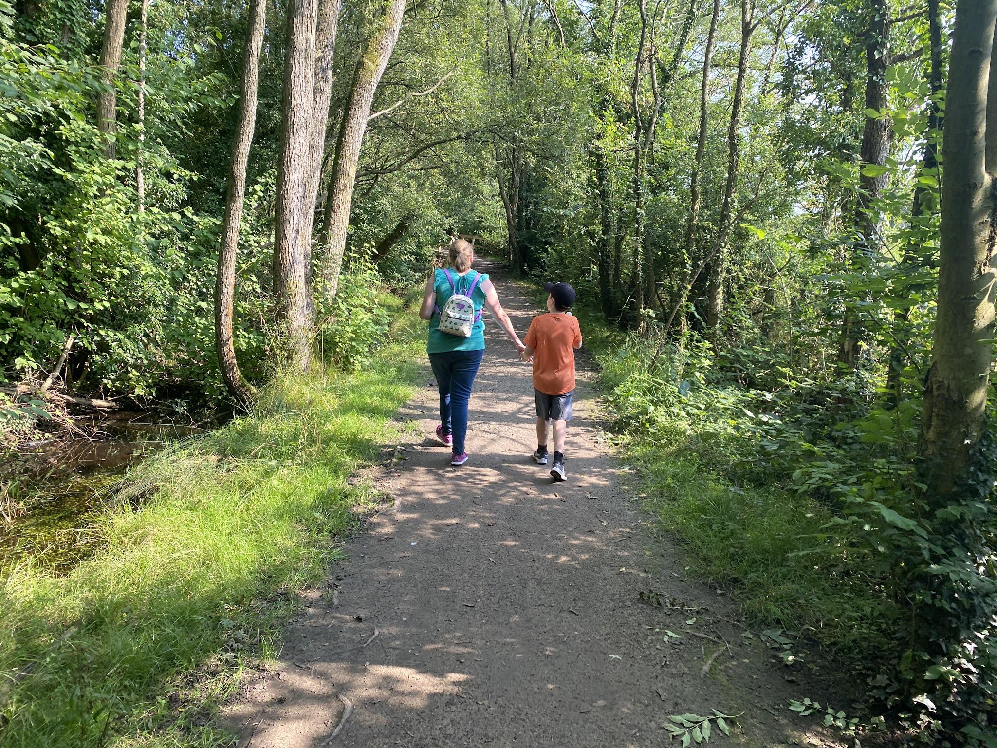 mum and son walking