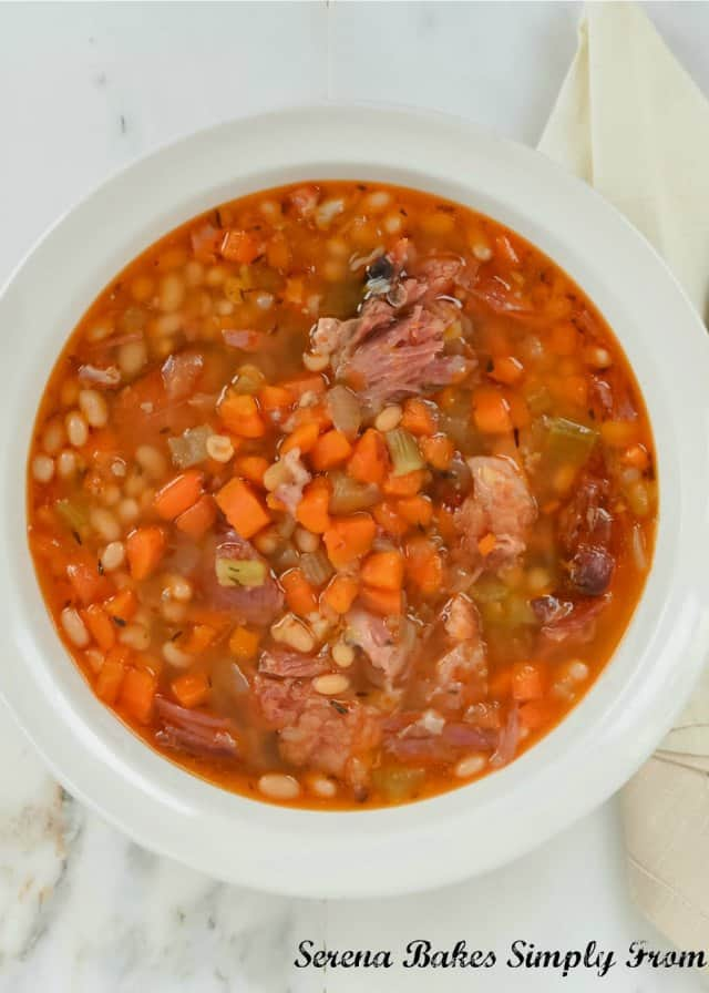 A favorite Ham and Bean Soup recipe is Crock Pot Chipotle Ham and Bean Soup. A great use for leftover ham bone or ham hock. A super simple and low cost meal from Serena Bakes Simply From Scratch.
