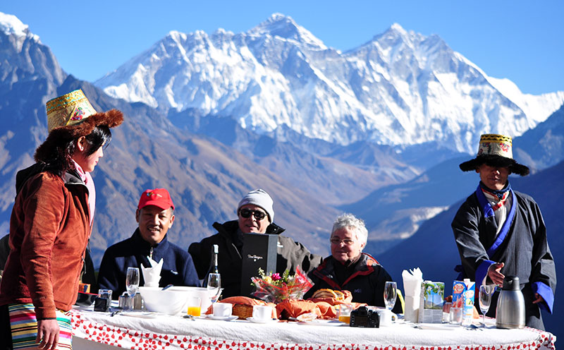 It's very happy for travelers to enjoy nice dishes at Everest base camp with friends.