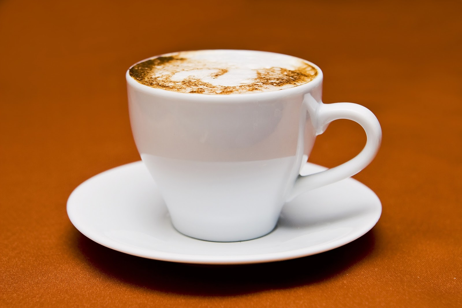 A cup of frothy cappuccino coffee