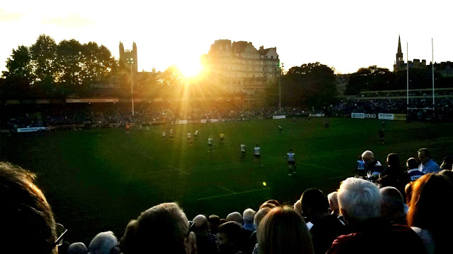 Sun setting over rugby match