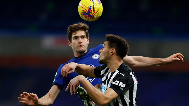 Chelsea defender Marcos Alonso battles with Newcastle player for the ball in the Premier League