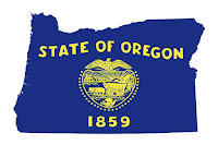 """The state of Oregon in blue with the text """"State of Oregon 1859"""" and the state seal in yellow."""
