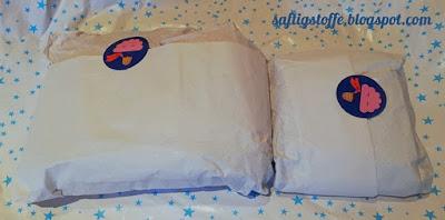 Geschenke in weißem Papier eingepackt mit einem niedlichen Sticker von Bonnie & Buttermilk darauf.