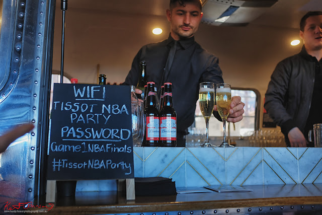 Serving drinks from the Vintage Airstream bar at the TISSOT NBA Finals Party Sydney - Photography by Kent Johnson.