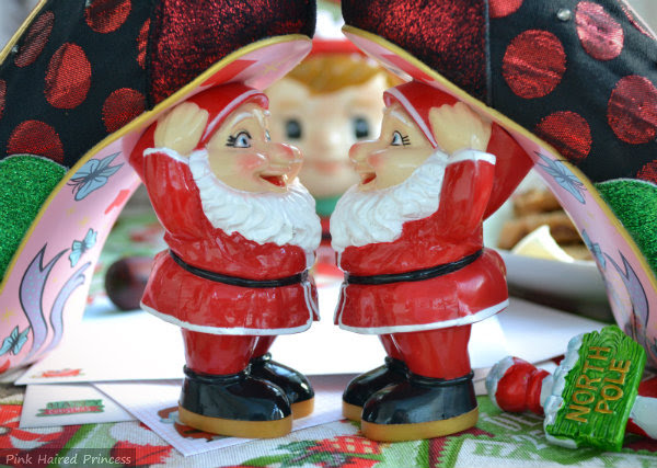 two Santa heels facing each other with elf face in background