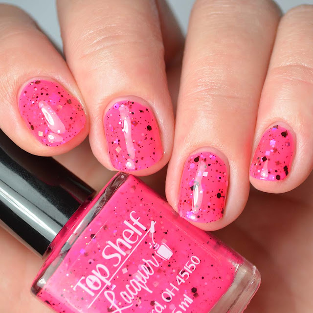 hot pink nail polish with black and iridescent glitter four finger swatch