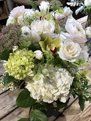 white hydrangea, orchid, roses