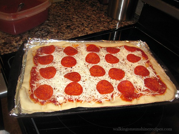 Pizza with pepperoni and mozzarella cheese ready to bake from Walking on Sunshine Recipes