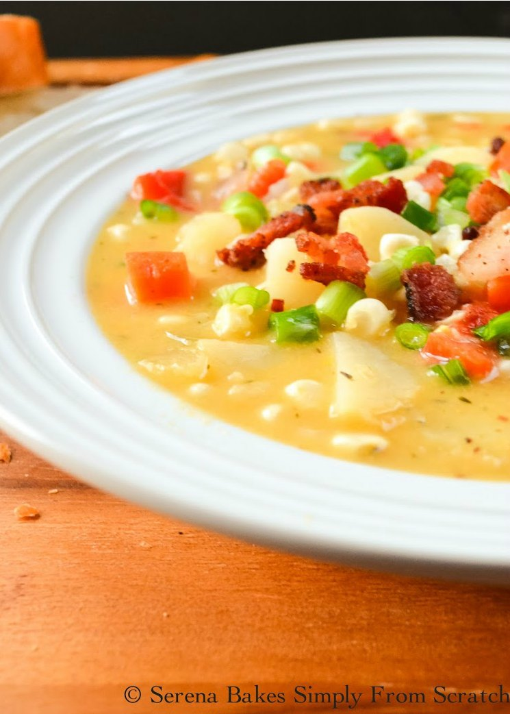 Cheddar Bacon Corn Chowder topped with crispy bacon bits and green onion in a white bowl.