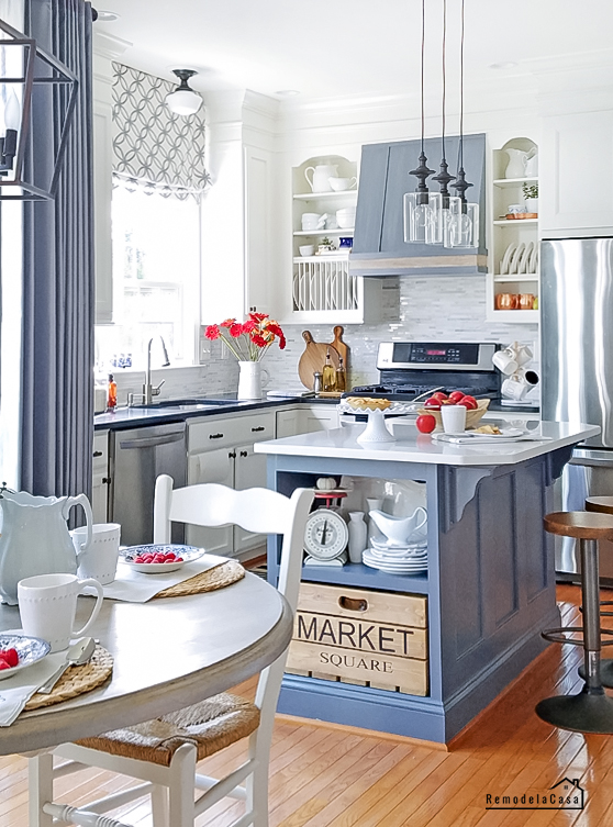 white and blue kitchen with red/orange pops of color