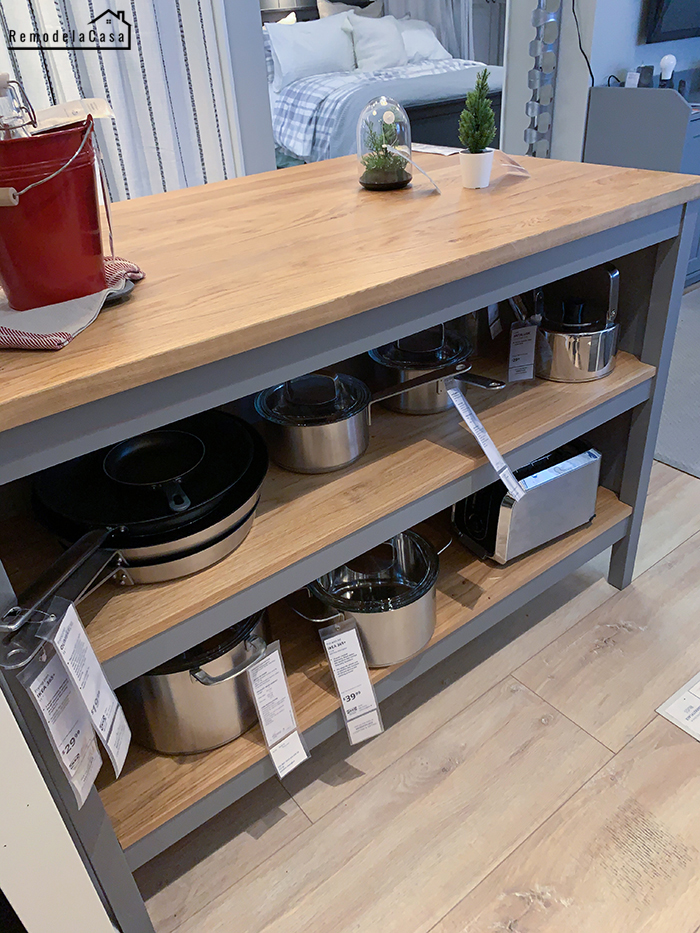 Kitchen island with ample cookware open storage