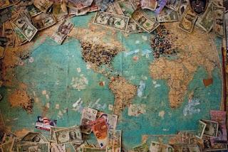 World Currency - Photo by Christine Roy on Unsplash