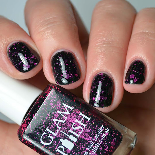 black nail polish with pink glitter four finger swatch
