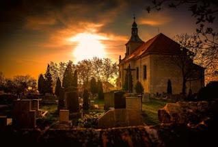 Church graveyard - Photo by Martin Vysoudil on Unsplash