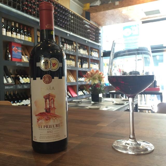 Bottle of Le Prieuré wine in wine shop