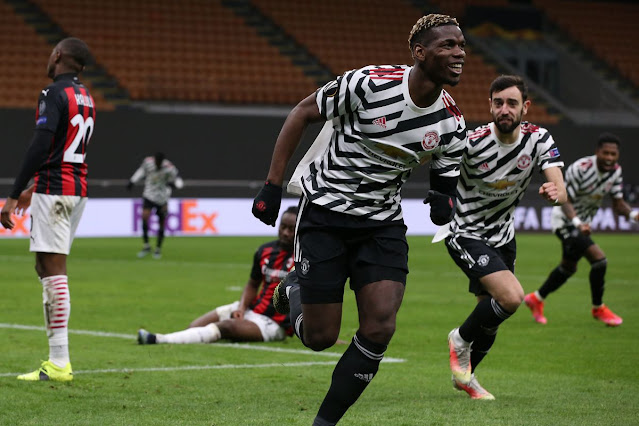 Paul Pogba celebrates as he scores winner for Manchester united away at AC Milan in Europa League