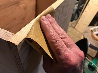 Lightly sanding the edges