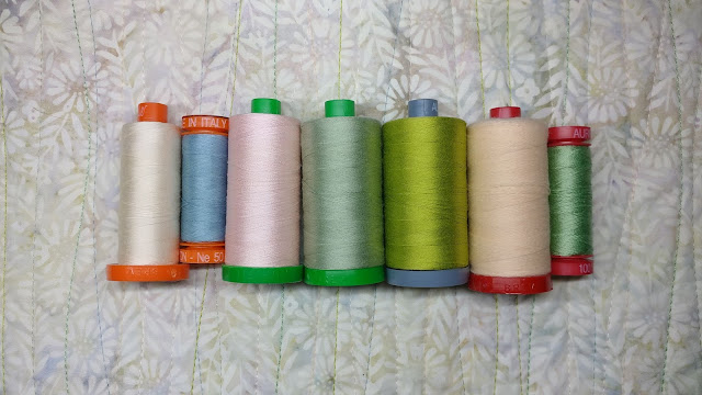 Aurifil thread in many weights used for machine quilting
