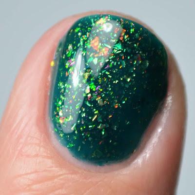green flakie nail polish close up swatch