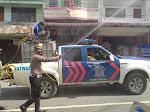 Serentak di Jajaran Poldasu, Polres Samosir Lakukan Penyemprotan Disinfektan di Kota Pangururan
