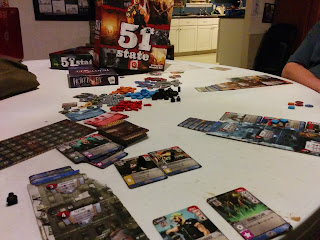 A game of 51st State in progress, with the game box visible in the background.