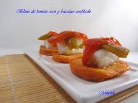 Blinis de tomate seco y bacalao confitado