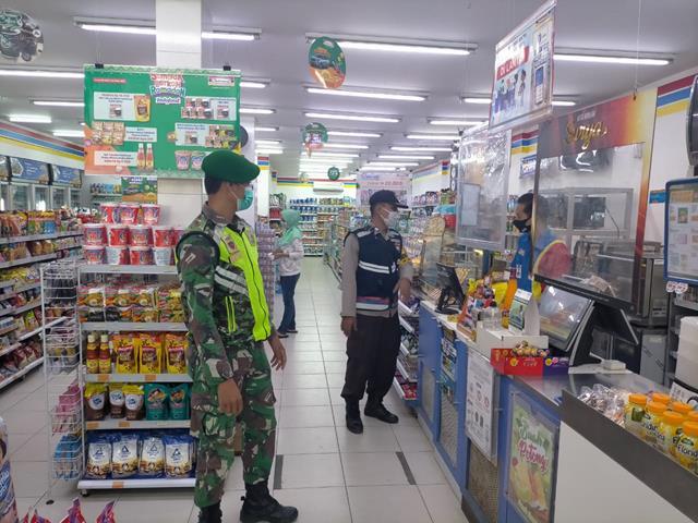 Personel Jajaran Kodim 0207/Simalungun Laksanakan Penegakan Disiplin Protokol Kesehatan Diwilayah Binaan