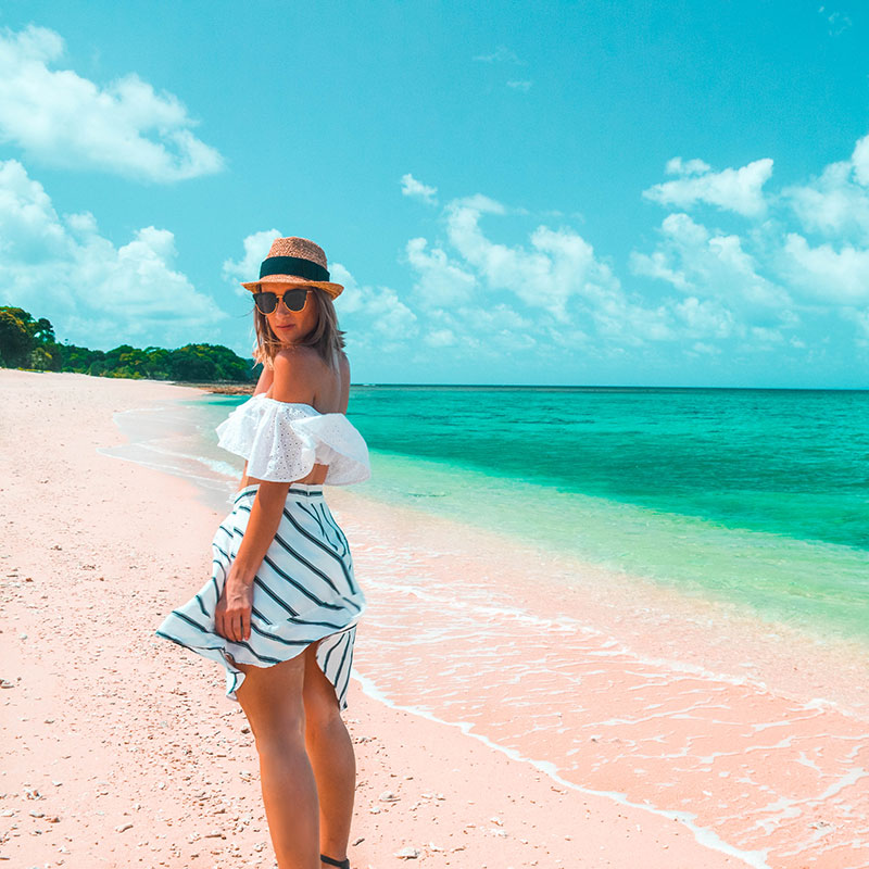 summer outfit frill white crop top stripe skirt straw hat on the frankland islands tropical north queensland