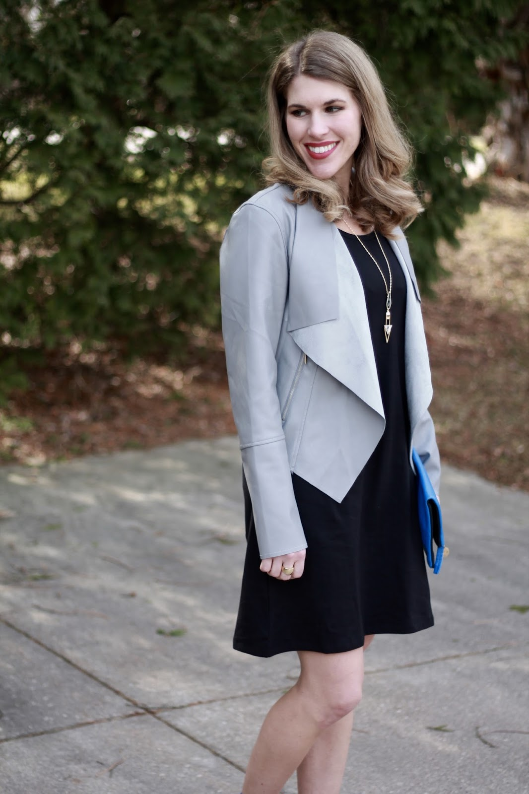 black tank dress, grey moto jacket, blue clutch, blue lace up flats for spring