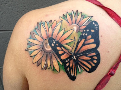 daisy tattoos with butterflies