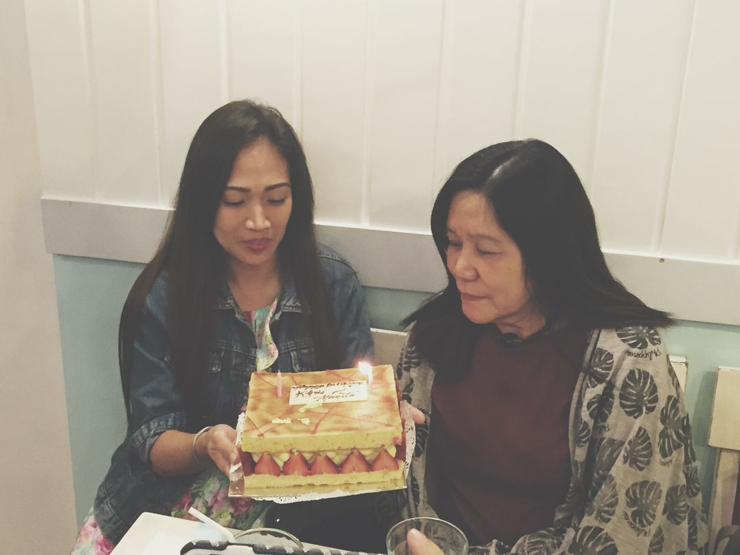 My monther-in-law blowing the candle on the birthday cake during our Stacy's BGC baby shower