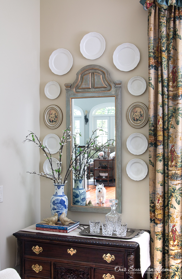 Gallery wall with mirror and plates