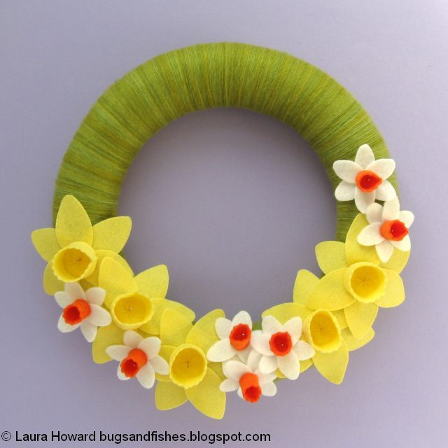 adding the flowers to the spring wreath